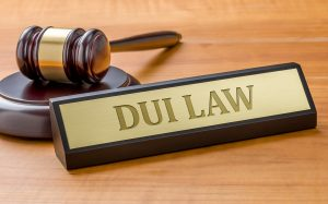 A gavel and a name plate with the engraving DUI Law